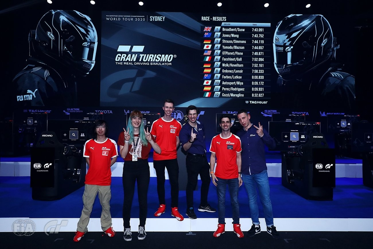 picture of Emily and other sim racers at a Gran Turismo tournament