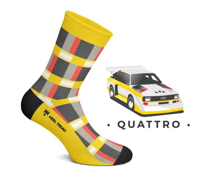 A pair of socks in the livery of a Group B rally Audi Quattro.