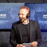 picture of Fragstube who is casting at an event, wearing a headset
