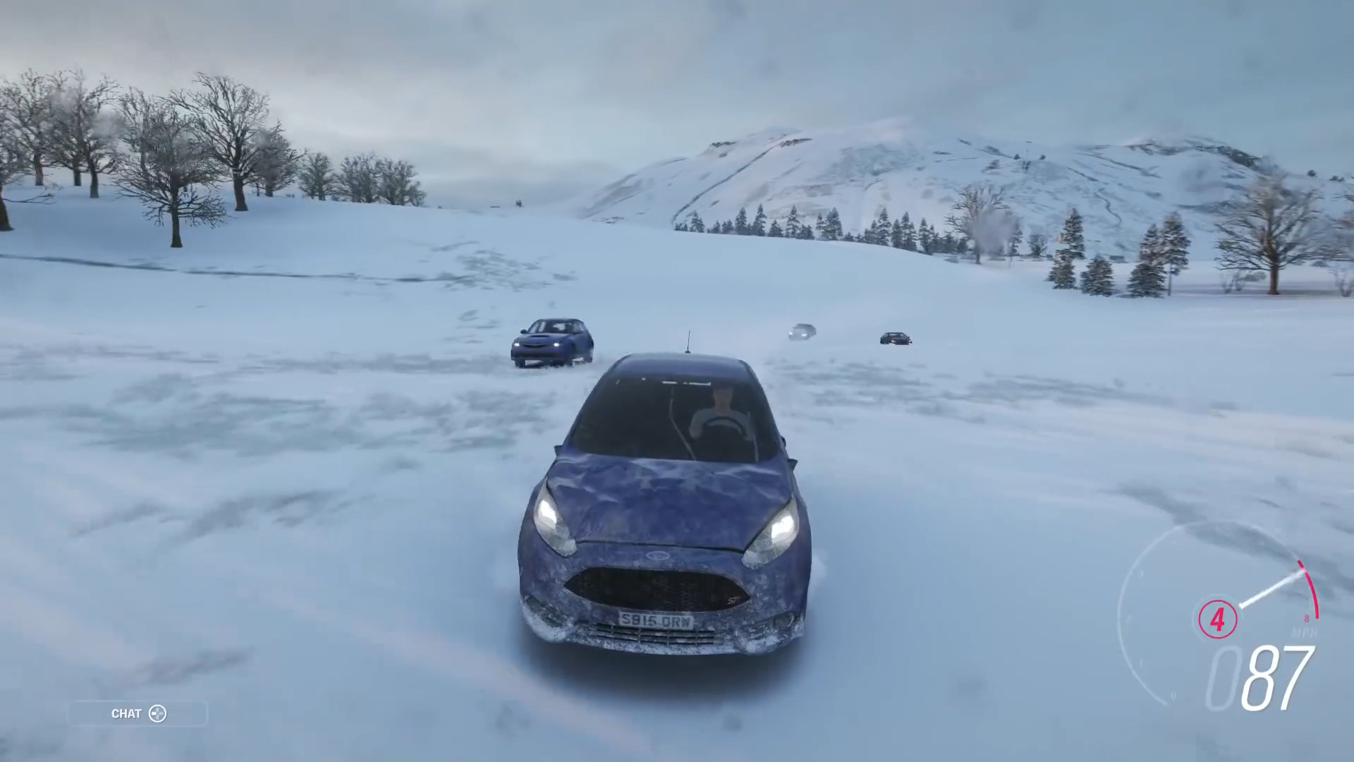 Alex driving away from three hunters in Forza Horizon 4 through the snow.