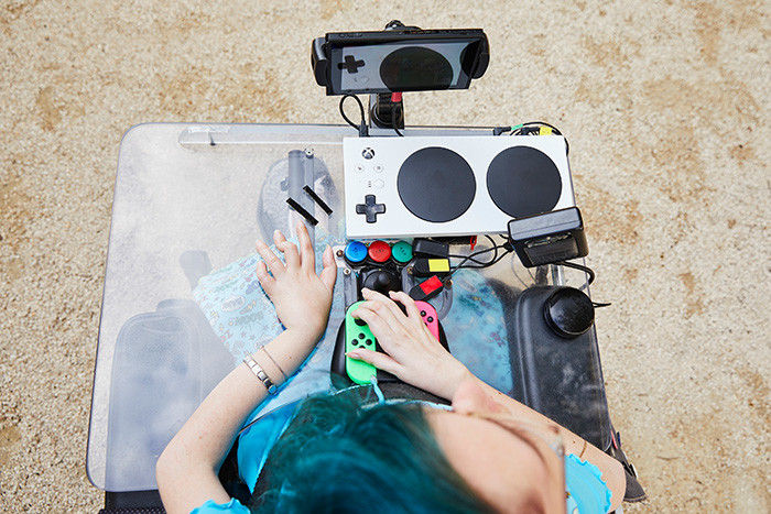 picture of Melly's wheelchair that is equipped with an Xbox Adaptive Controller and Nintendo Switch