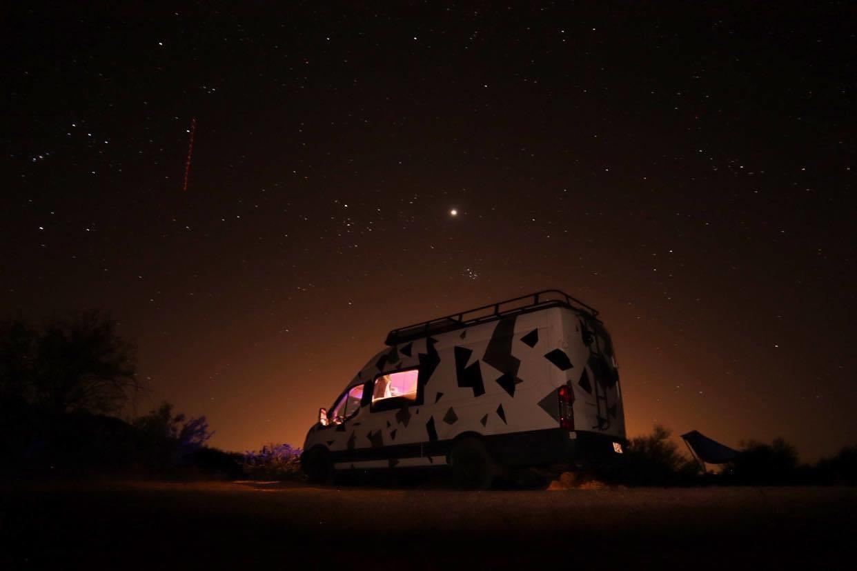 Van in front of the night sky