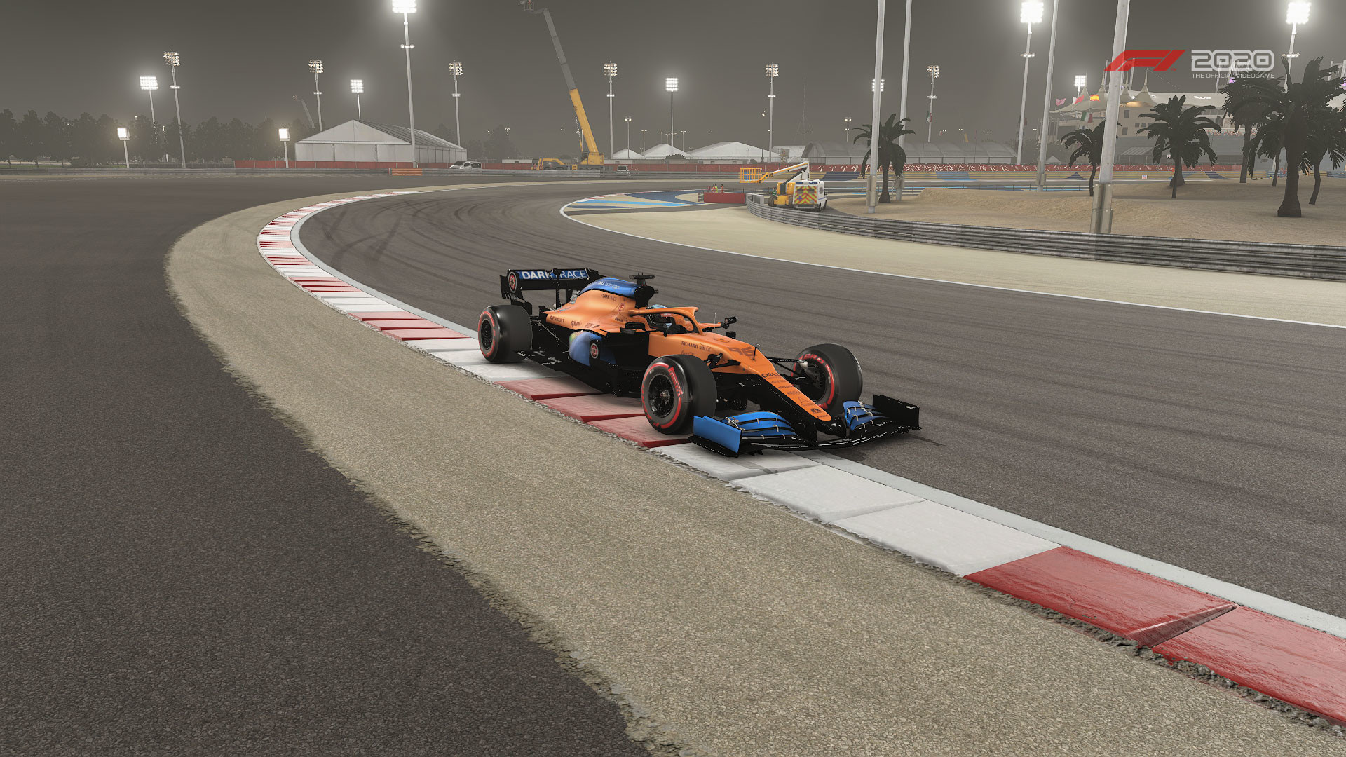 car on the outer kerb of Turn 11