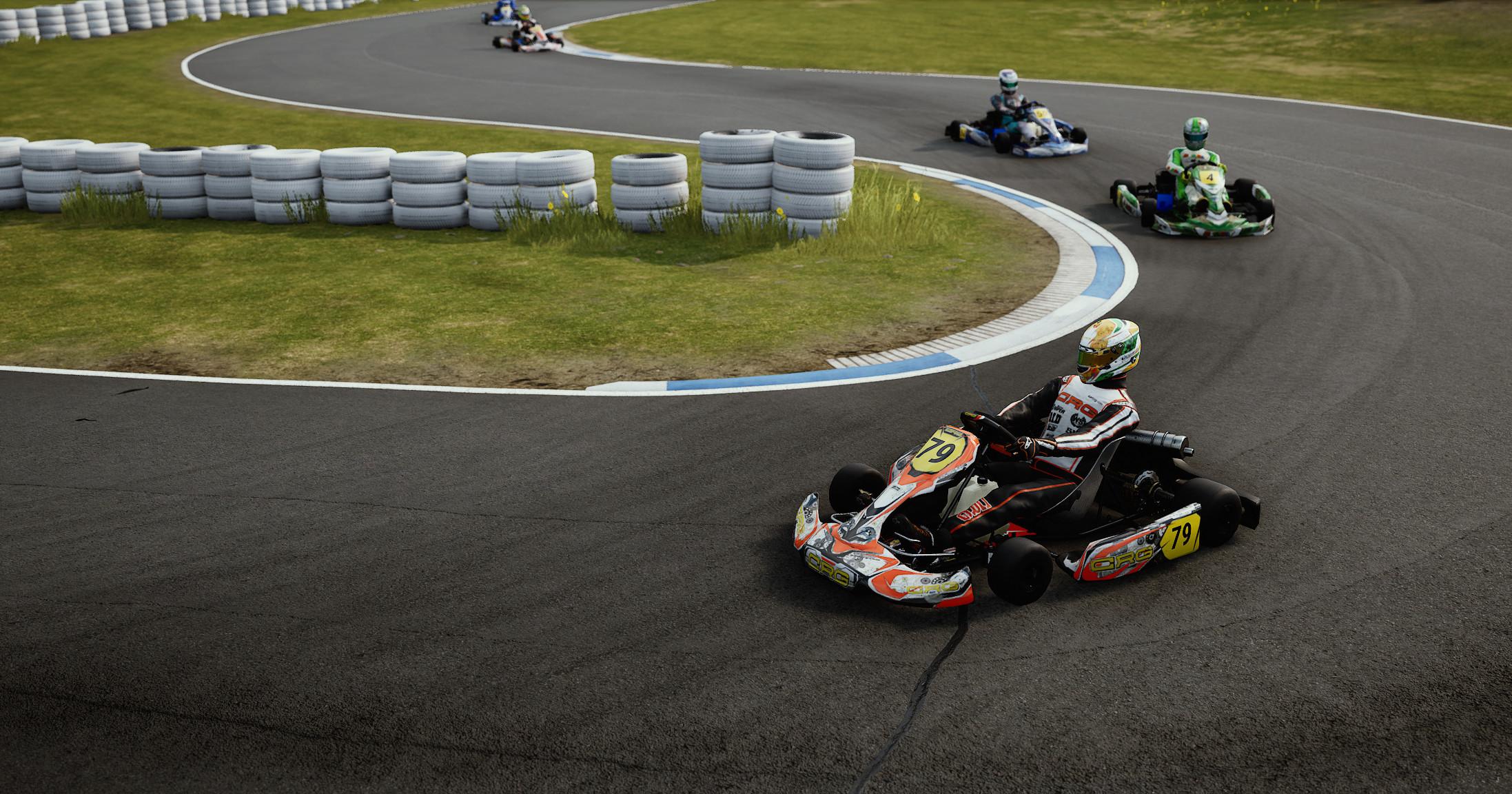 Three karts driving around a corner towards viewer.