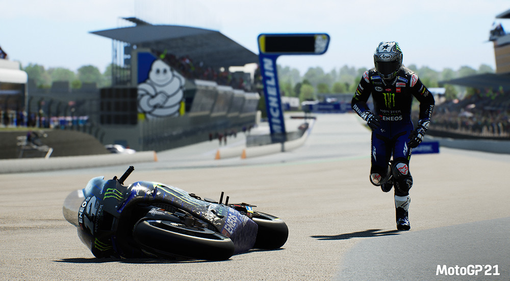 An image of a motorbike racer running towards his fallen bike on the racing track.