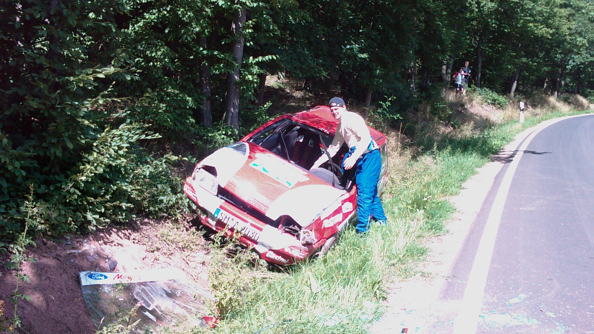 damaged rally car at the side of the road