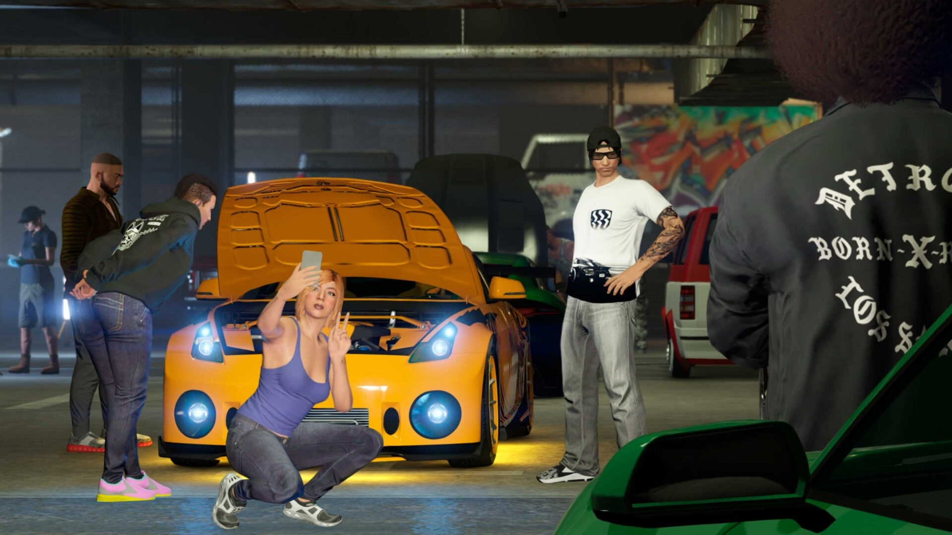Image of a car meet with people posing in front of a roadster.