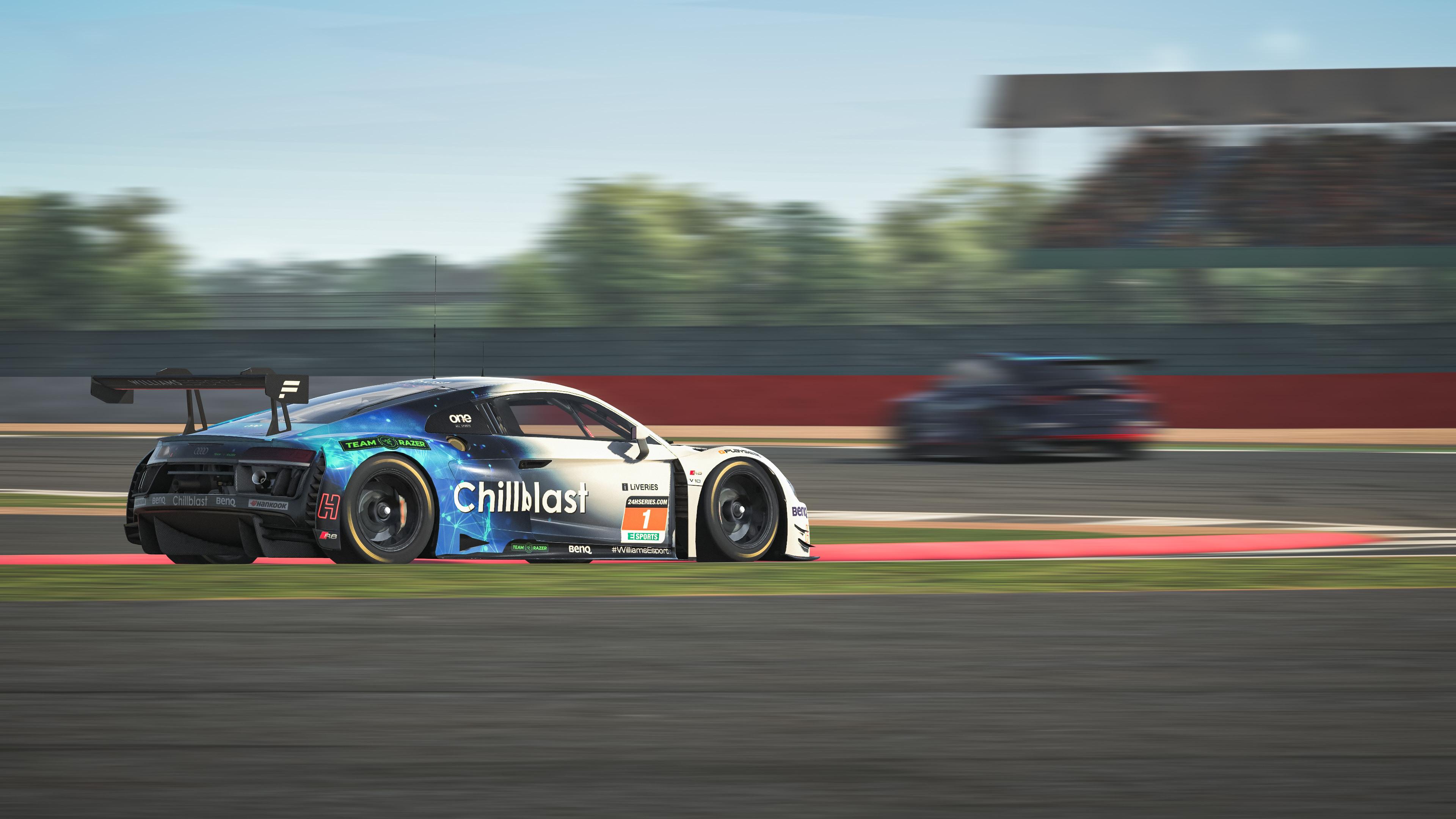 An image of an Audi GT car cornering hard.