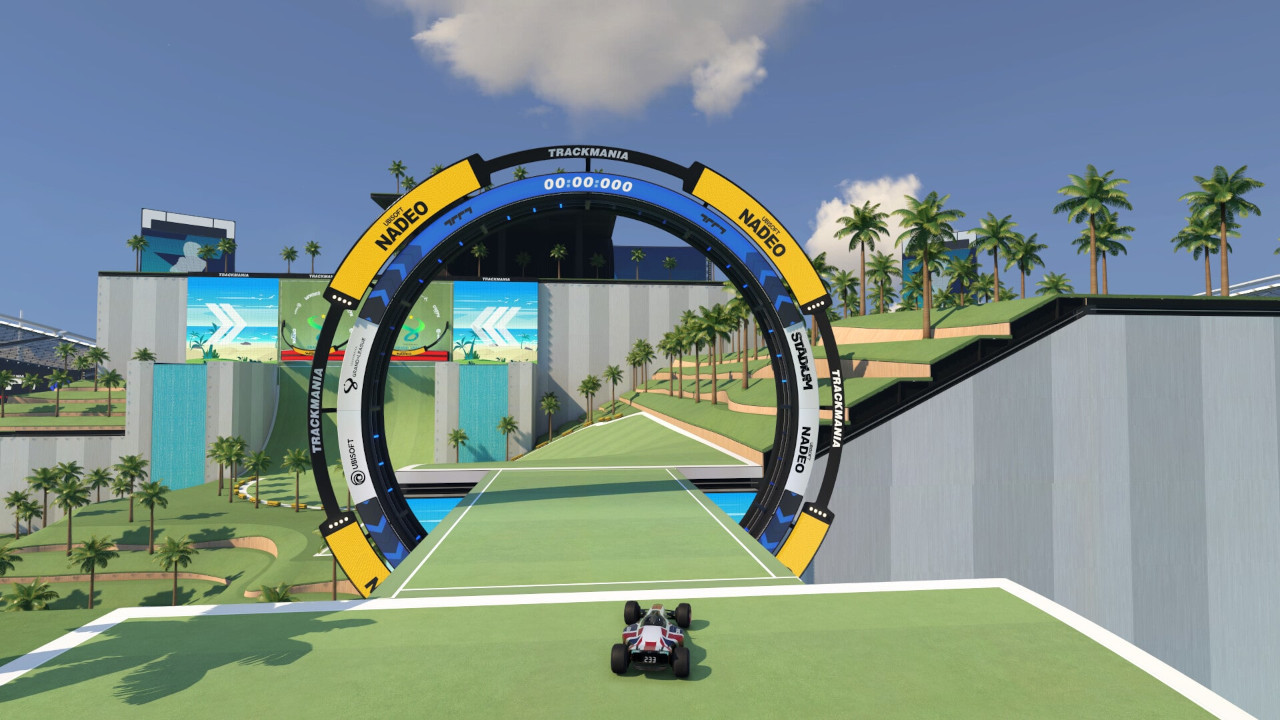 An image of a car about to pass through the final checkpoint in map 03 in Trackmania.