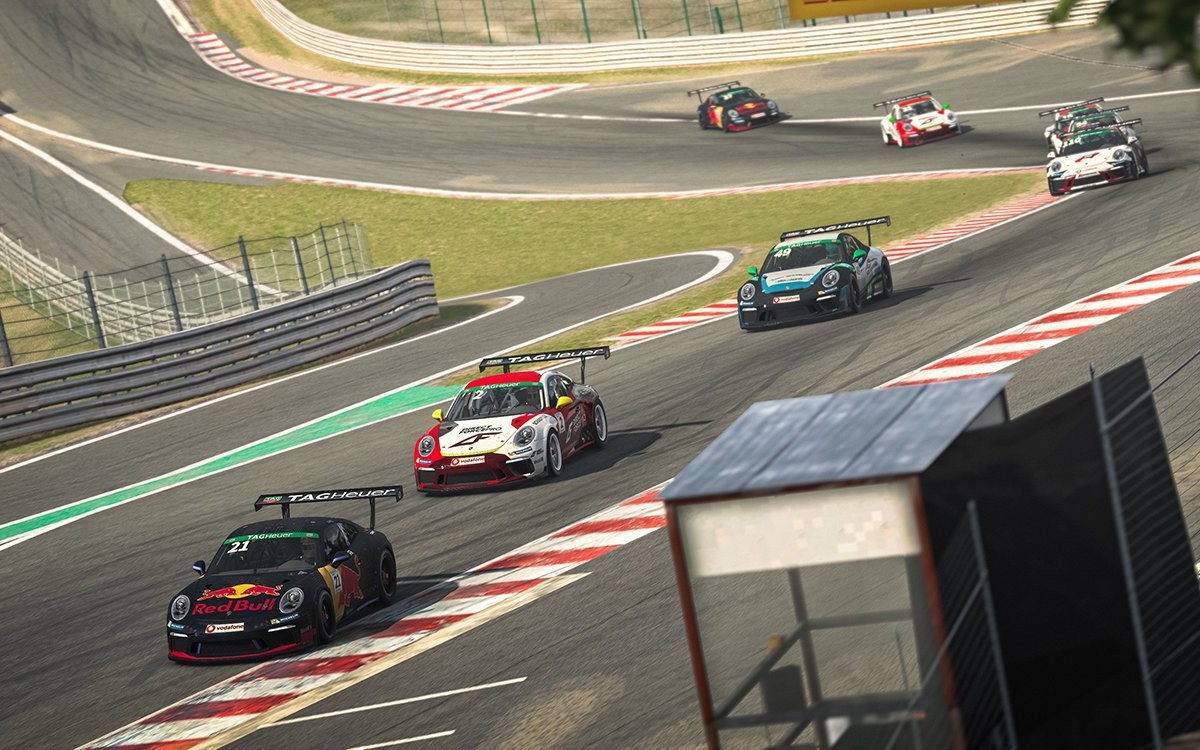 An image of a field of Porsches racing in the Porsche tag heuer esports supercup in iRacing.