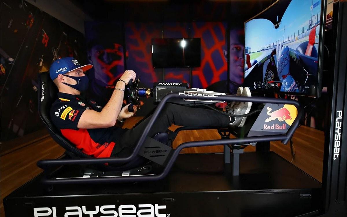 Max Verstappen on a Playseat sim rig driving a Super Formula car around Suzuka on Gran Turismo Sport.