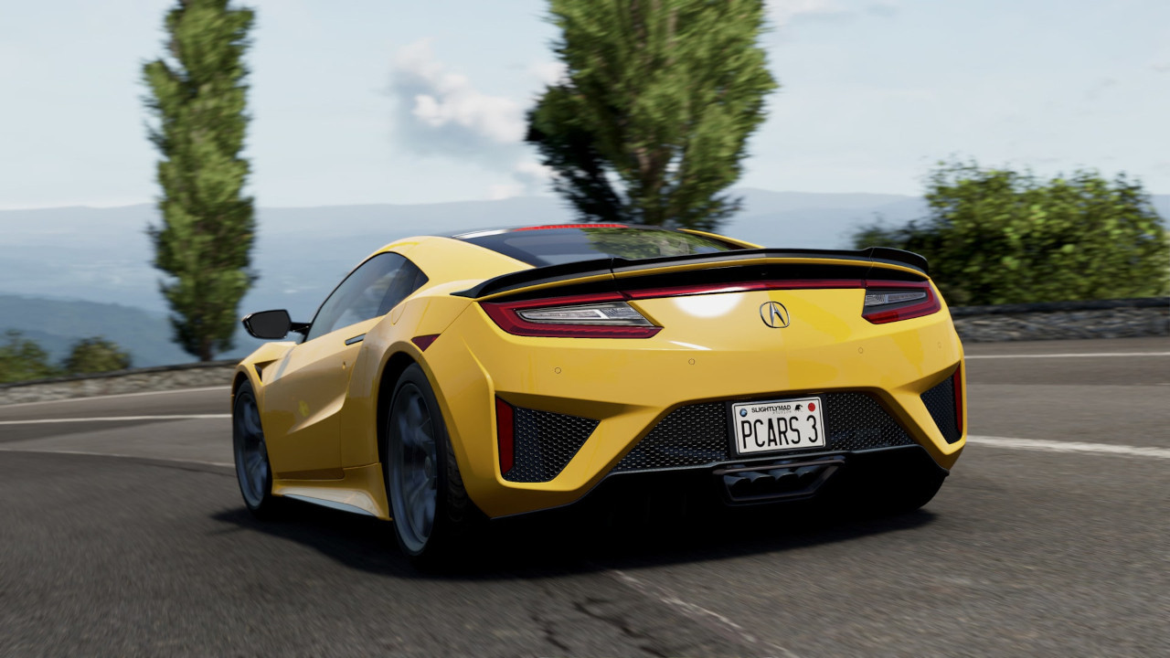 An image of a yellow supercar driving on a mediterranean mountainside in Project Cars 3.